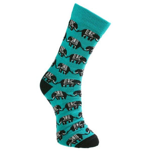 Turquoise blue fair trade bamboo socks with black and white elephants in lines tail to trunck. They have black heels and toes.