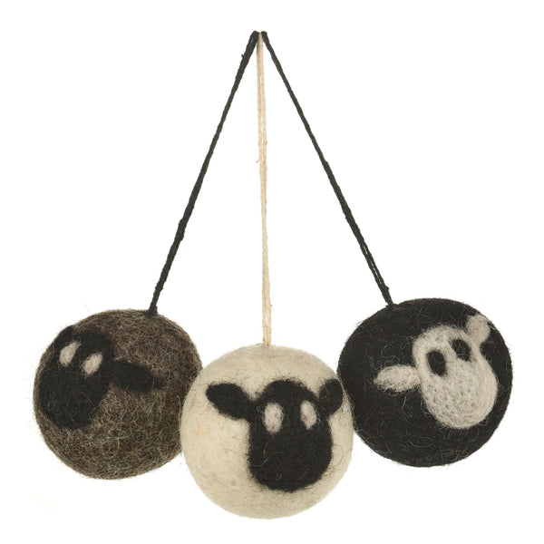 Set of three round sheep baubles in grey, black and white with contrasting black or white faces