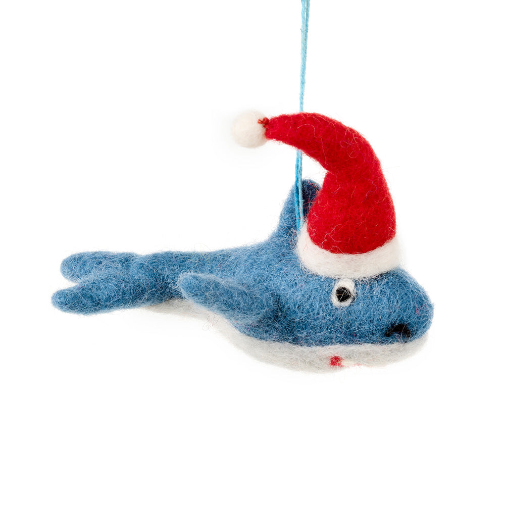 Blue felt shark decoration wearing a red Santa hat
