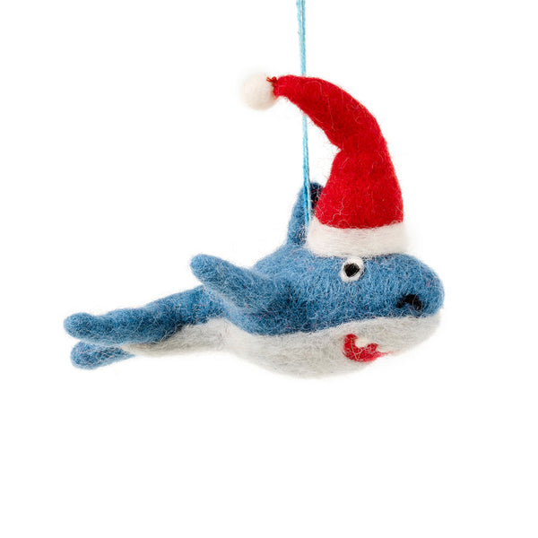 Blue felt shark decoration wearing a red Santa hat with a toothy grin