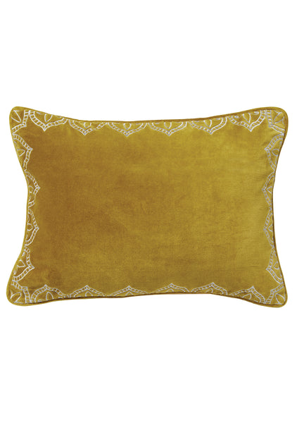 Old gold rectangular velvet cushion with silver embroidery around the edge on a white background