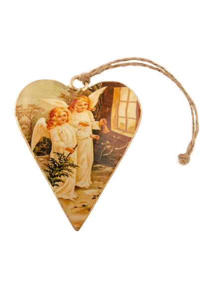 A heart shaped Christmas decoration showing a vintage picture of two cherubs carrying a Christmas tree. Main colours are ivory and gold