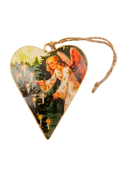 A heart shaped Christmas decoration showing a vintage picture of an angel lighting candles on a Christmas tree. Main colours are green, red and gold