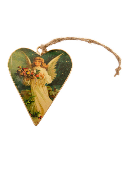 A heart shaped Christmas decoration showing a vintage picture of an angel carrying stocking fillers. Main colours are ivory and dark blue