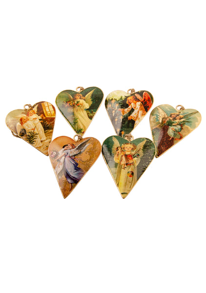 A set of six heart shaped tin Christmas decorations with vintage pictures of angels, on a white background