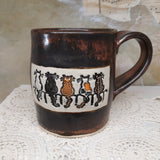 copper/blk cats on fence mug