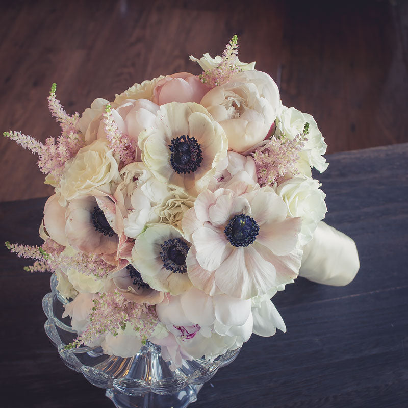 All white bridal bouquet with Anemone flowers.