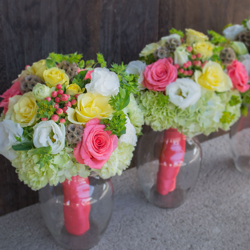 Bridal bouquets with bright Spring colors such as yellow, pink, green and a dash of white.