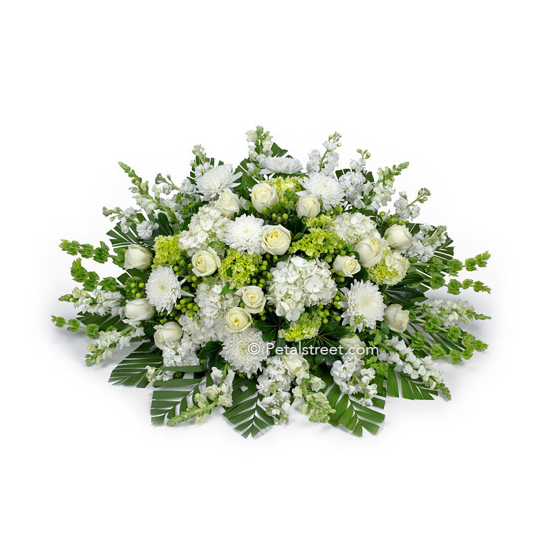 All white flower casket spray with Roses, Mums, and Daisies by Petal Street Flower Company.
