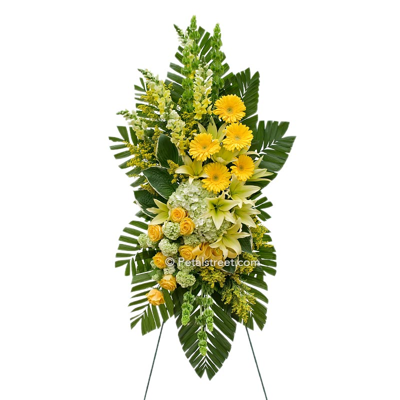 Large standing spray with yellow Lilies and Daisies, and green Hydrangea by Petal Street Flower Company florist.