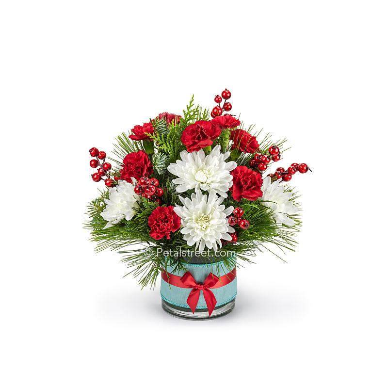 Vintage style Christmas flower arrangement with red, white, and robin egg blue colors this pieces has white Mums, red mini Carnations, mixed seasonal greens, and faux red Berries.