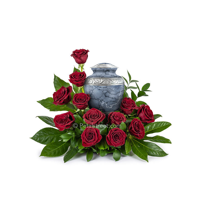 Circular arrangement of red Roses and foliage made for a cremation urn which can be placed in the center.