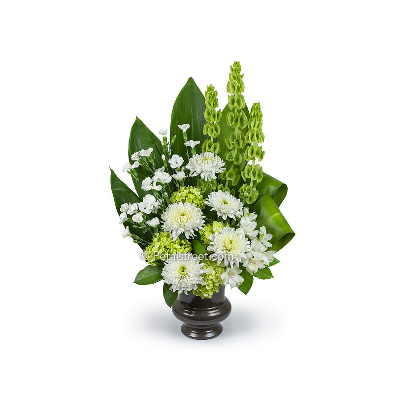 Funeral Basket with white Mums, Dianthus, and Alstromeria, green Hydrangea, Bells of Ireland, Ti Leaves, and accent greener.