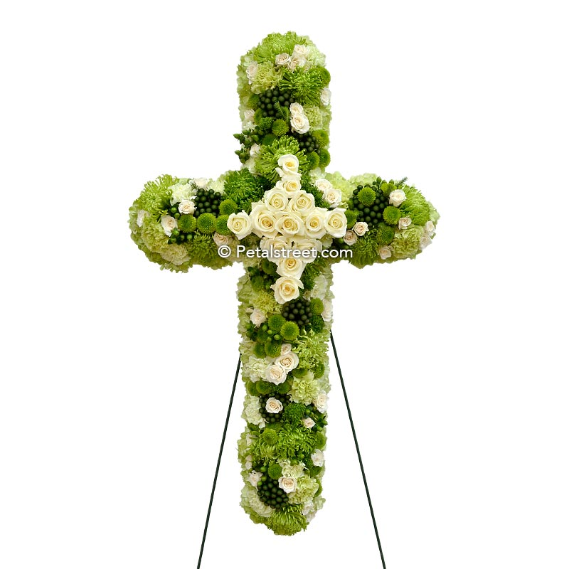 Irish funeral cross with green and white flowers including Roses, Carnations, Green Trick, and Hydrangea.