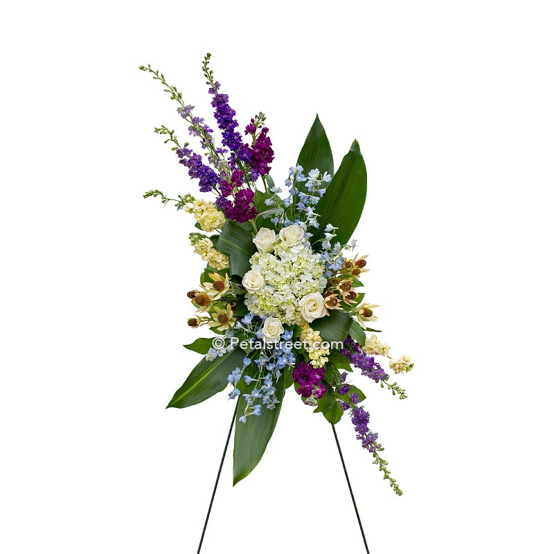 Stylish standing spray custom shaped has Roses, Hydrangea, and Delphinium, a beautiful piece to have delivered.