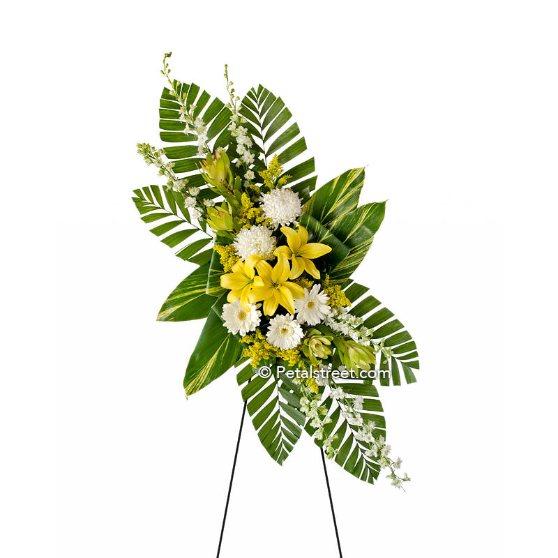 Yellow Lilies and white accent flowers in a funeral standing spray by Petal Street Flower Company, Point Pleasant florist.