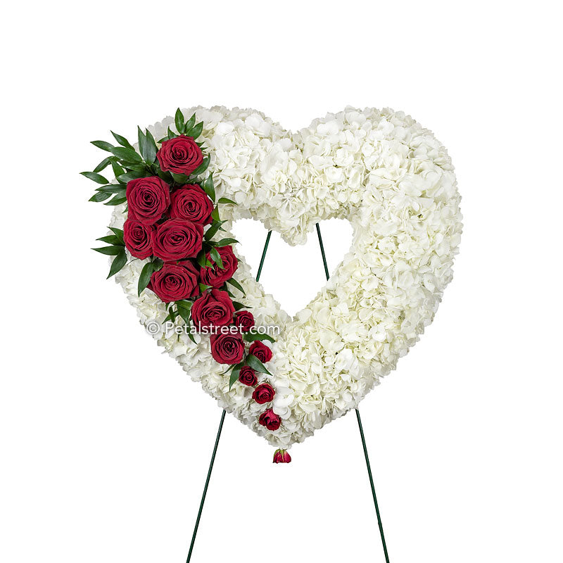 An elegant Funeral flower Bleeding Heart wreath with red Roses and white Hydrangea by Petal Street Flower Company florist in Point Pleasant, NJ.