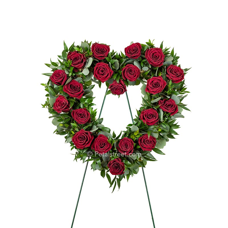 Open Heart funeral wreath with red Roses, Eucalyptus, and mixed foliage accents.