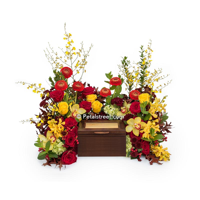 Beautiful cremation urn flowers by Petal Street Flower Company, a Point Pleasant, NJ florist. Yellow Roses, orange Daisies, and stunning Orchids.