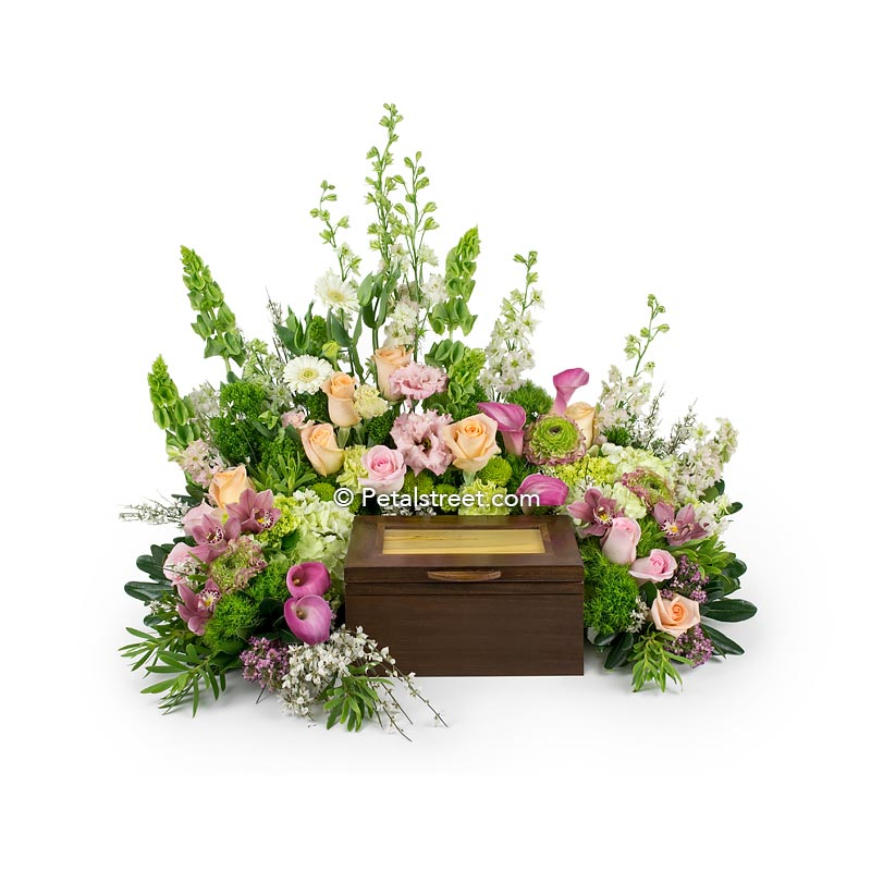 Cremation urn flower arrangement with pink peach Roses, pink Calla Lilies, green mini Hydrangea, and bells of Ireland.