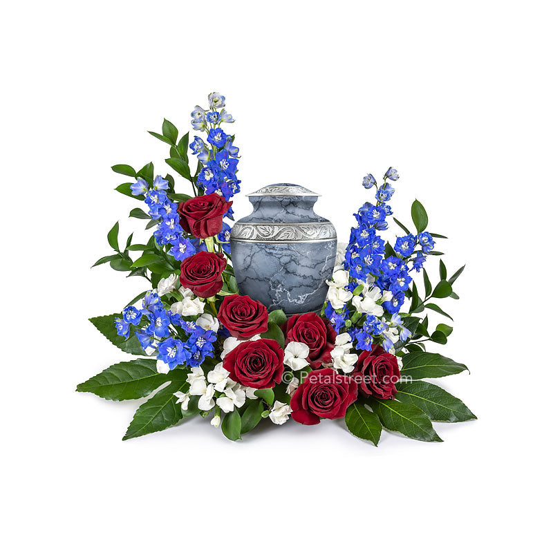 Patriotic red, white, and blue flowers for cremation urn with Roses, Dianthus, and Delphinium accented with lush greenery.
