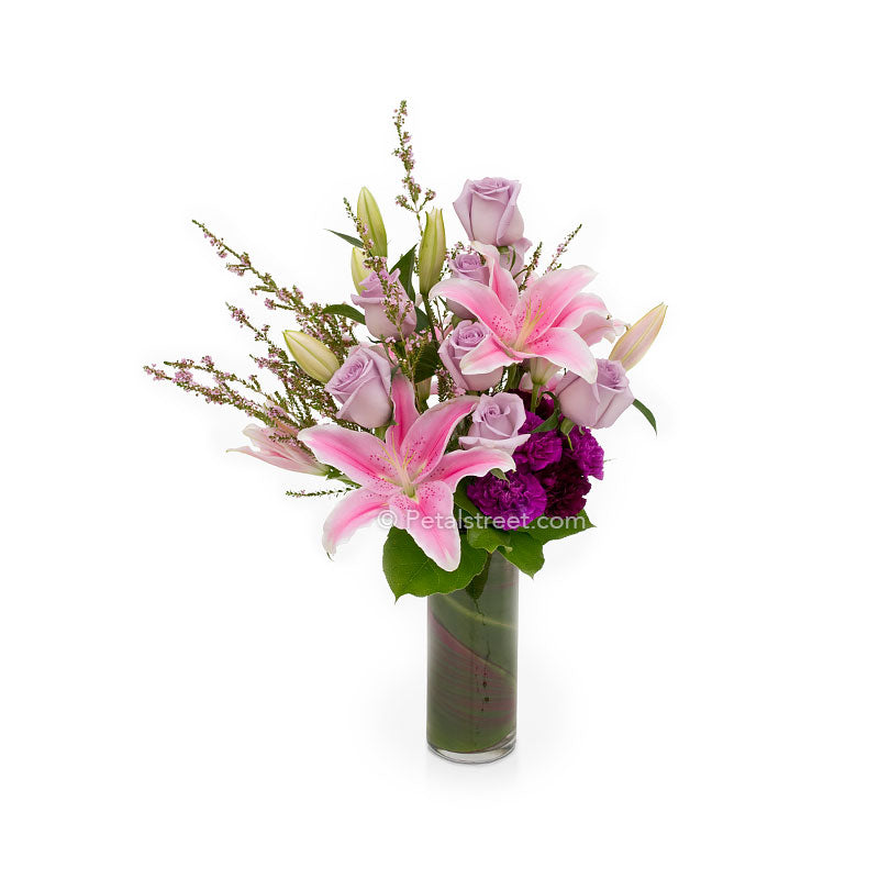 Beautiful anniversary flowers with pink and lavender Lilies and Roses by Petal Street Flower Co.