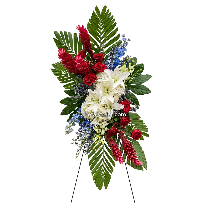 Red, white, blue funeral standing spray with Lilies, Roses, and Hydrangea by Petal Street Flower Company florist.