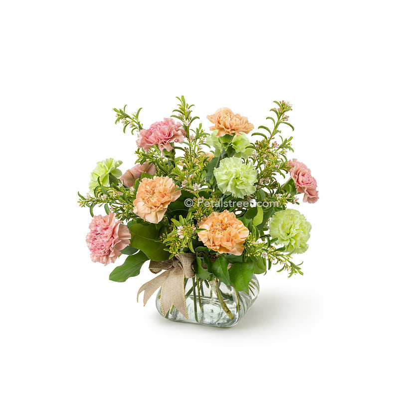 Mixed carnations in soft colors arranged in a vase with mini accent flowers and greenery by Petal Street Flower Company florist in Point Pleasant NJ