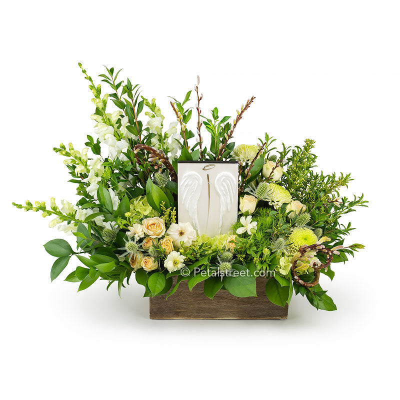 Sympathy flowers for delivery with Angel Wings in Point Pleasant NJ. Flowers include white Roses, hydrangea, Snapdragons, Thistle, and curly Willow all arranged in a box with the keepsake custom art piece included.