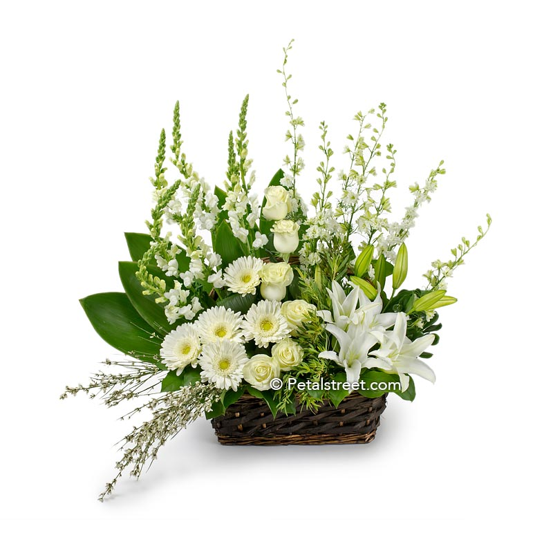 Gorgeous garden style sympathy flower basket with white Gerbera Daisies, Roses, Lilies,  Snapdragons, and accent greenery.