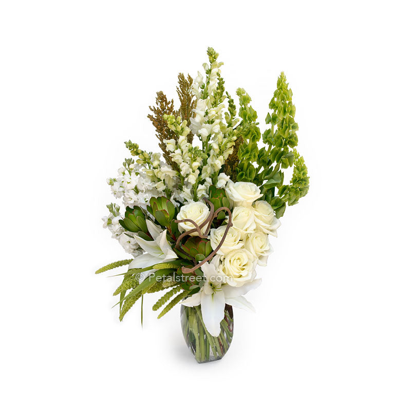 Large vase with white Roses, Bells of Ireland, white Stock, green Leucadendron, and assorted accents.
