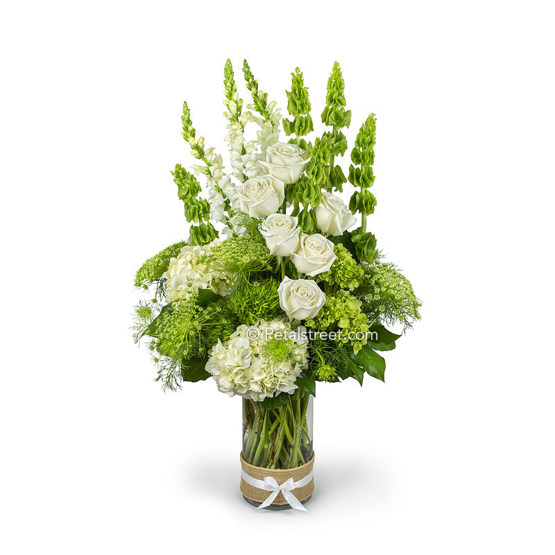 Gorgeous Irish flower arrangement with green and white flowers such as Roses, Bells of  Ireland, Hydrangea, and Snap Dragons.