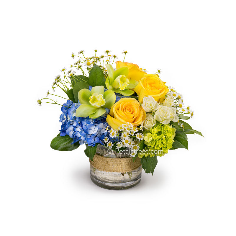Yellow Roses and green Orchids with mixed flowers in a vase that will make for a very happy flower delivery!