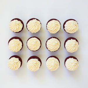one dozen red velvet cupcakes