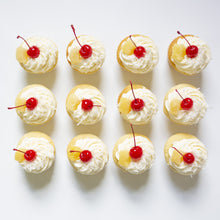 Load image into Gallery viewer, one dozen piña colada cupcakes