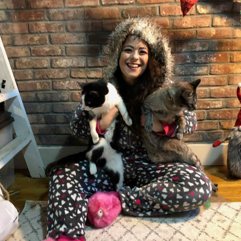a woman with two cats