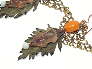 Leather feathers with vintage elements and Artisan Enamel