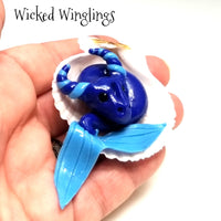 Menegan - Hand Sculpted Mini Polymer Clay Sea Dragon in Shell - Wicked Winglings