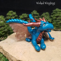 Somena - Hand Sculpted Polymer Clay Dragon with Eye of Shiva Shell - Wicked Winglings