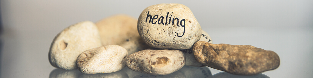 Rocks with the word healing written on one