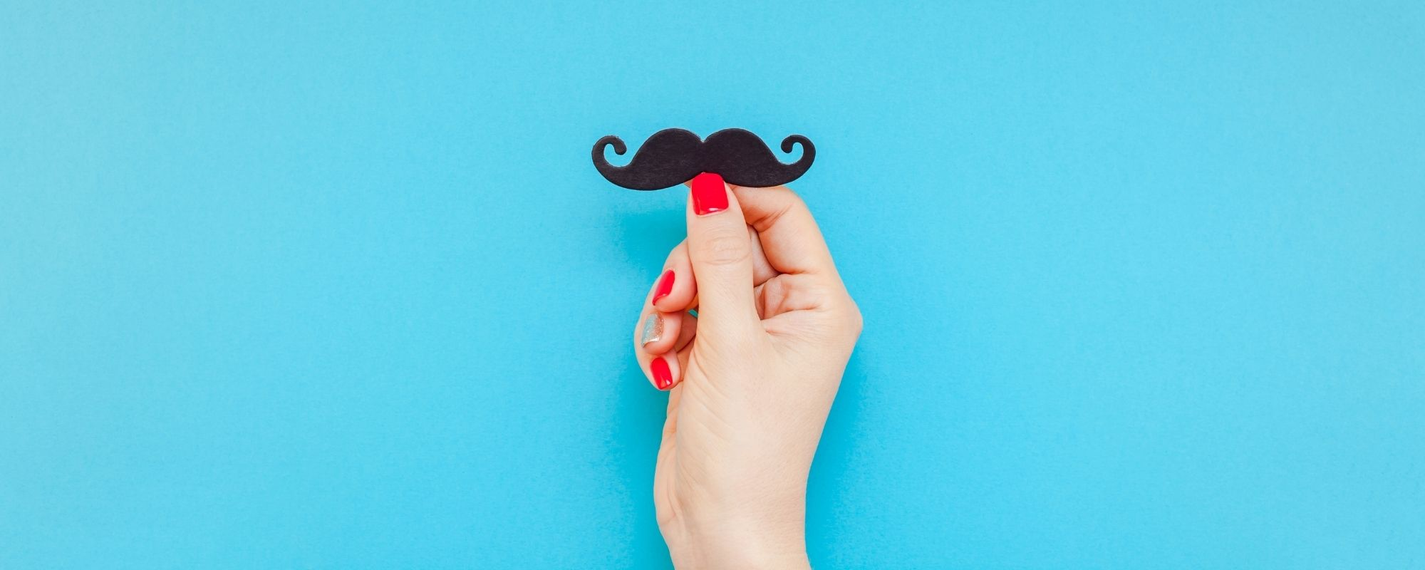 Woman holding mustache for men's health