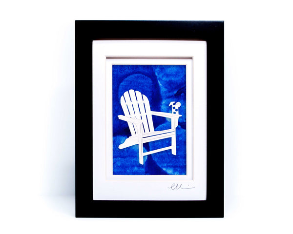 White beach adirondack chair with drink on chair arm papercut on hand painted blue bubble background.