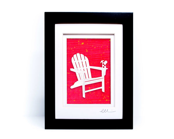 White beach adirondack chair with drink on chair arm papercut on hand painted neon pink background.