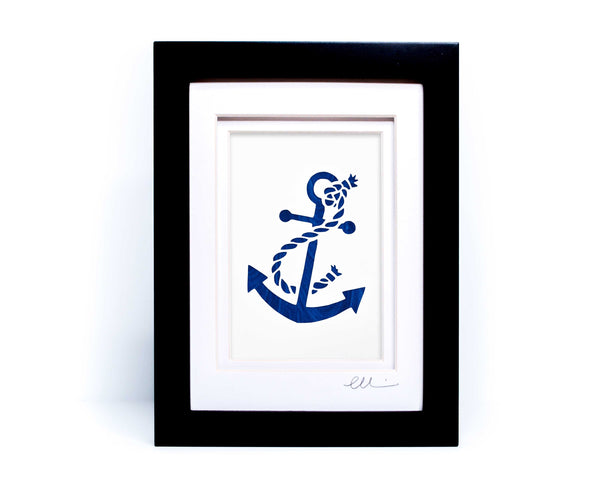White nautical anchor twisted with rope papercut on hand painted blue wave background.
