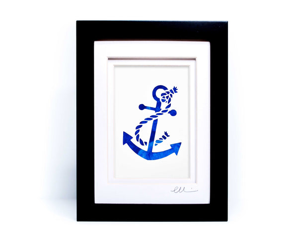 White nautical anchor twisted with rope papercut on hand painted blue background.