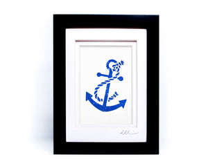 White nautical anchor twisted with rope papercut on hand painted bright blue splattered background.