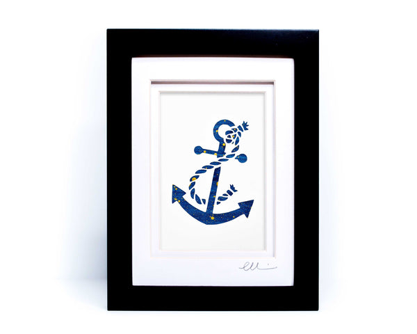 White nautical anchor twisted with rope papercut on hand painted dark blue background.