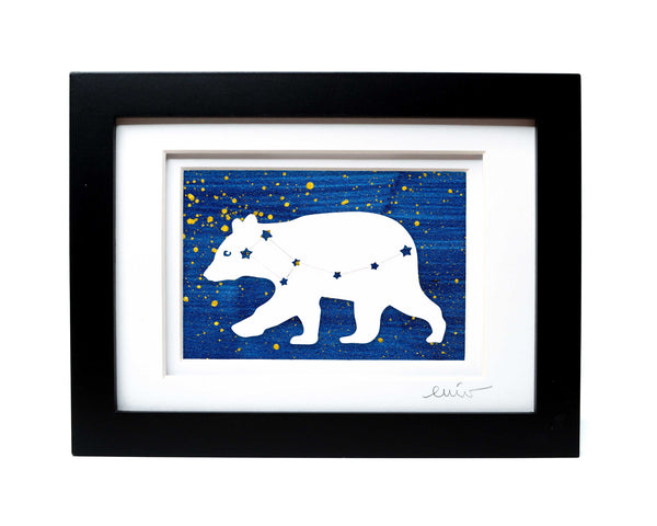 White Ursa Major bear constellation papercut on hand painted dark blue splatter background.