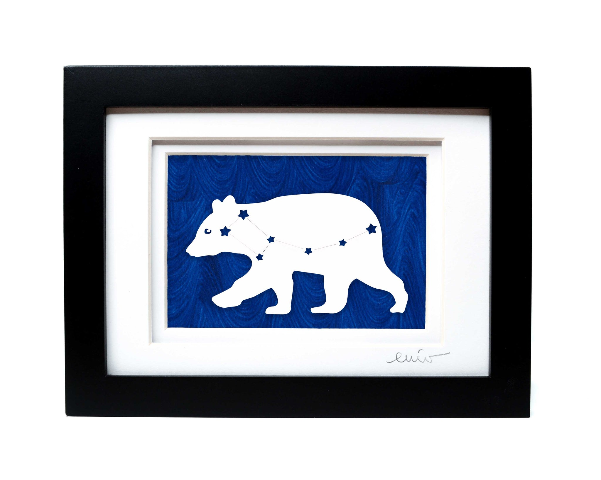 White Ursa Major bear constellation papercut on hand painted dark blue background.