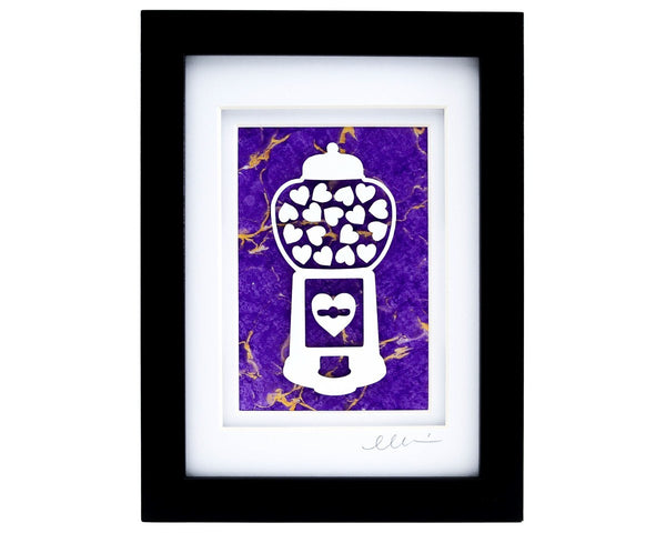 Framed heart filled gumball machine paper cut with purple hand marbled paper background.